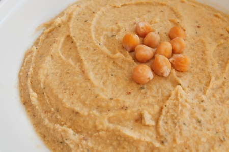 hummus spread on the table decorated  with boiled chickpeas Stock Photo