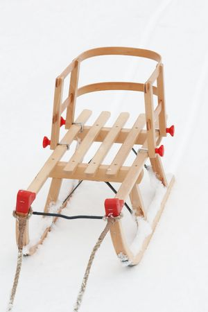 wooden  childrens' sleigh on a clean fresh snow Stock Photo - 5829207
