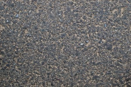 asphalt covered with sand background photo