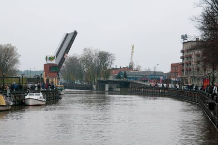 major overhaul: KLAIPEDA, LITHUANIA – NOVEMBER 10: the second drawbridge ready for pass of Klaipeda city symbol barquentine Meridianas  to the major overhaul on November 10, 2012 in Klaipeda.
