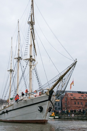 oldtown: KLAIPEDA, LITHUANIA – NOVEMBER 10: Klaipeda city symbol barquentine Meridianas on her way to the major overhaul  on November 10, 2012 in Klaipeda. Editorial