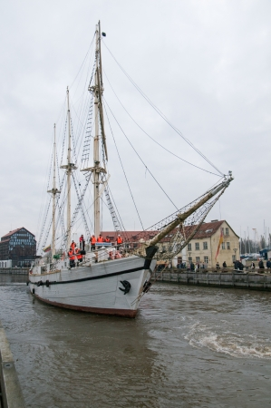 oldtown: KLAIPEDA, LITHUANIA – NOVEMBER 10: Klaipeda city symbol barquentine Meridianas  approaches river mouth on her way to the major overhaul  on November 10, 2012 in Klaipeda. Editorial