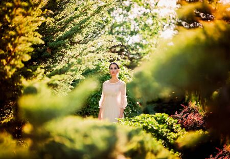 Beautiful lady in sunlight garden. Dreamy portrait of young woman in vintage dress. Beauty fairy-tail wedding concept. Stock fotó