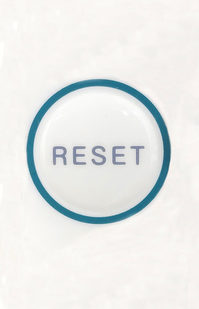 A round button for reset close up shot from top view.