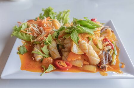 Close up of fried squid with salted eggs, Thai food. Stock Photo