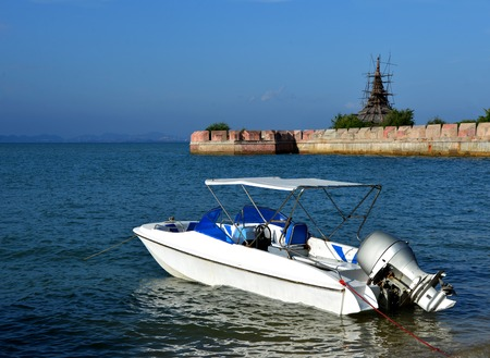 Anchored motor boat at seaside Thai