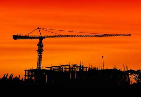 Cranes in construction site on blue sky photo