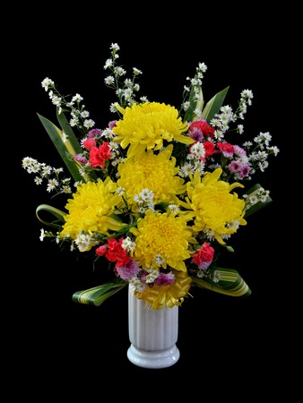 Bouquet of flower in vase isolated on black