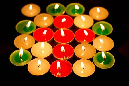 Cross of color light candles photo