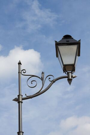 Old latern on blue sky Stock Photo