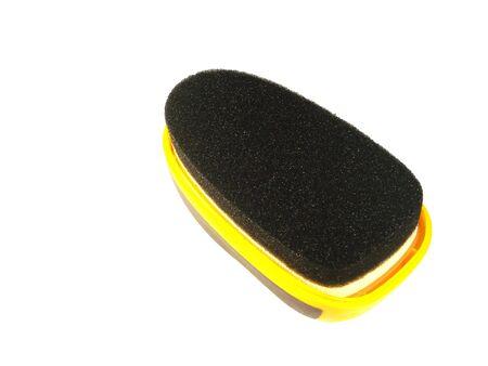 Yellow sponge for black shoes                        Stock Photo