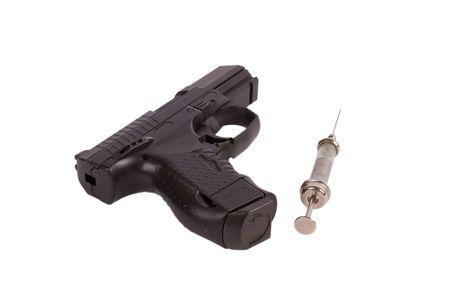 Gun and syringe isolated on white