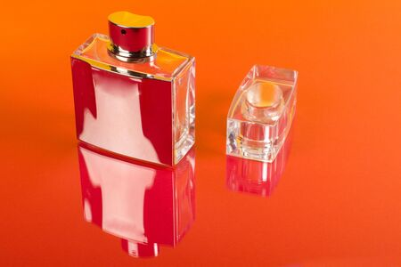 Bottle of perfume isolated on the red