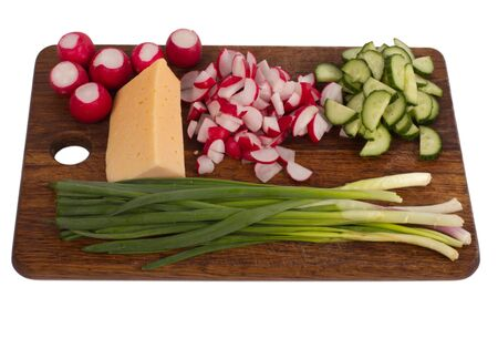 Salad ingredients on the wooden board  photo