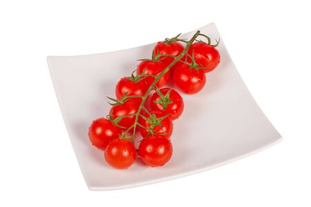 Wet whole tomatos arranged isolated on white Stock Photo