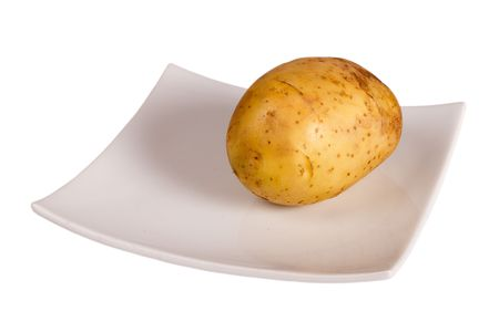 Potato on the plate isolated in white