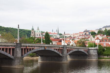 View of buildings and a bridge over Vltava river in Prague, the Czech capital.