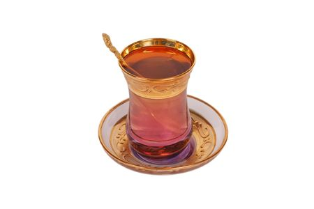 yellow tea pot: Oriental cup of tea with spoon