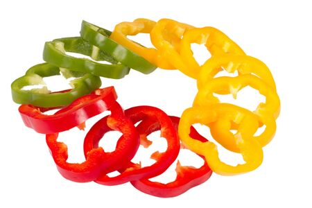 Ring of green, yellow and red bell pepper rings Stock Photo