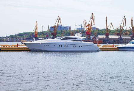 White yacht in sea port Stock Photo