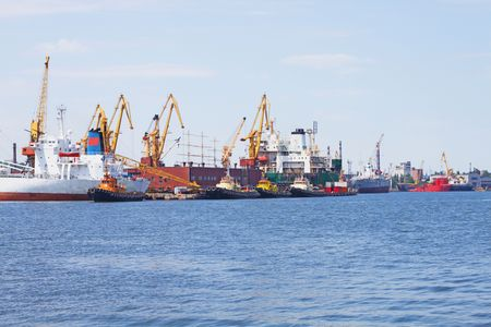 View on trading port with cranes and ships