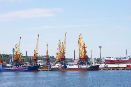 View on trading port with cranes and ships photo