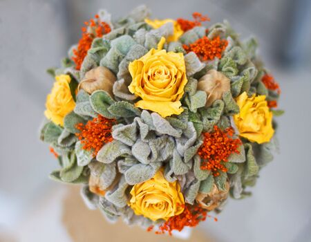 Bouquet of yellow roses on gray background