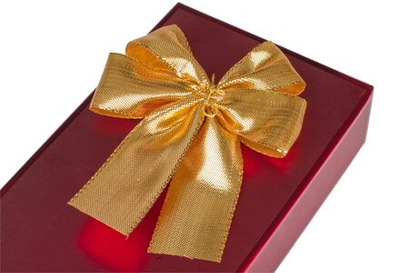 One red gift box with gold ribbon and bow isolated v.2 photo