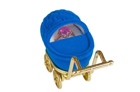 Blue baby stroller with gold ring isolated in white