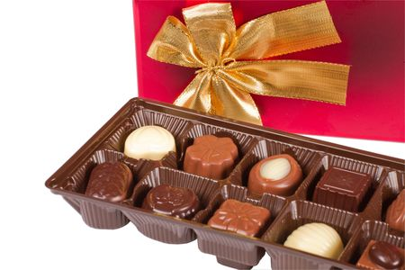 box of chocolates: Sweet tasty chocolate candies with a red box isolated on white background