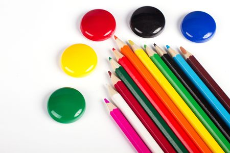 Colored pencils with round button photo