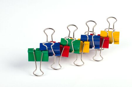 Multicolored paper clips on white background Stock Photo - 7235196