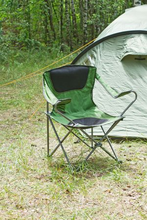 Green chair near a touristic tent