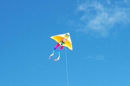 Surfing kite in blue sky photo
