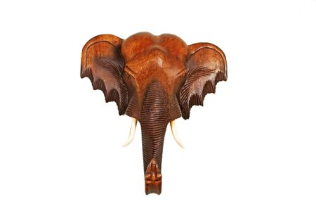Red wooden elephant head isolated on white background photo