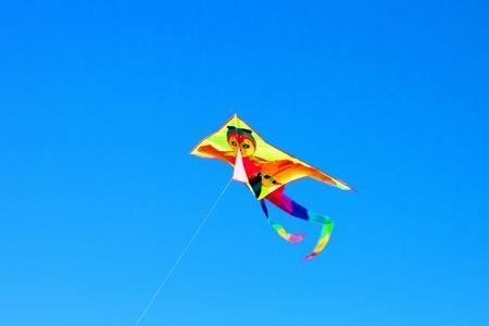 Surfing kite in blue sky