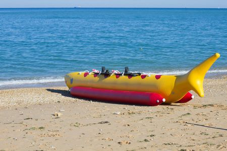 Banana boat as shark lays on a beach