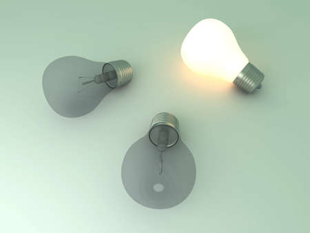 enlightened: A glowing light bulb between others. 3D rendered Illustration.  Stock Photo