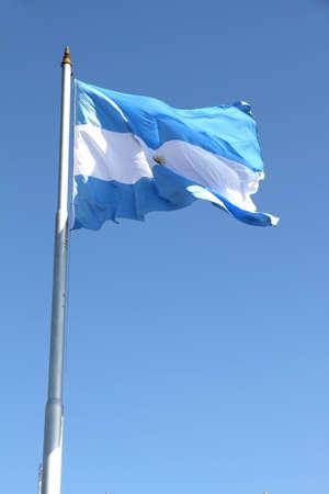 The Argentine Flag on blue sky. photo