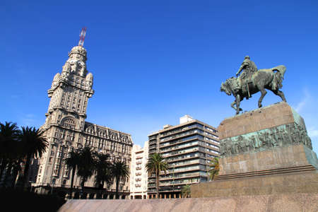 montevideo: The Plaza independencia in Montevideo, Uruguay. The Palacio Salvo in the Background and the Monument of the grave of General Artigas in the Foreground.