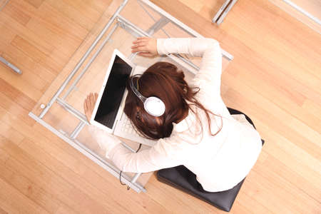 A woman sleeping on the Laptop. photo