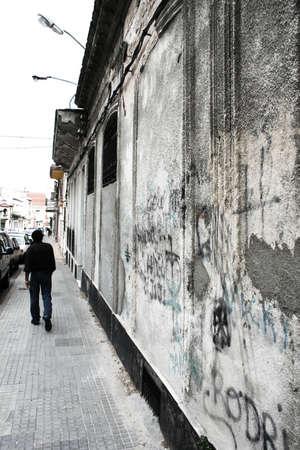 A man walking along the sidewalk in Palermo, Montevideo, Uruguay.
