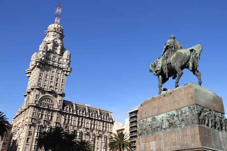 The Plaza independencia in Montevideo, Uruguay. The Palacio Salvo in the Background and the Monument of the grave of General Artigas in the Foreground.