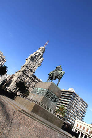 artigas: The Plaza independencia in Montevideo, Uruguay. The Palacio Salvo in the Background and the Monument of the grave of General Artigas in the Foreground.