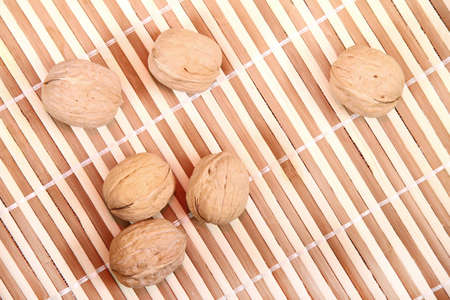 Some walnuts on a bamboo background