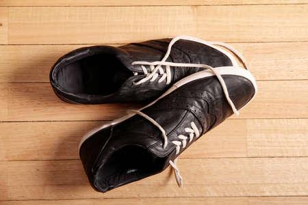 Black sneakers on the floor  photo