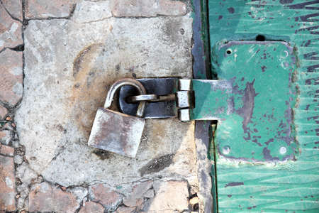 A rusty metal plate background with a padlock Stock Photo - 12941680