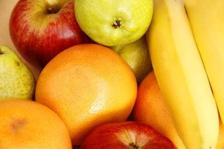 A background of Fruits - Oranges, Bananas, Apples and Pears  photo