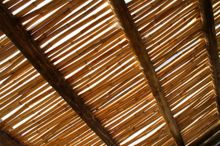 A bamboo roof against the sky  photo
