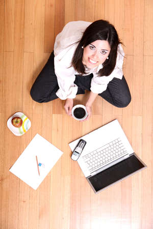 apple computer: A young adult woman studying on the floor